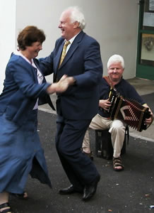 Muiris Ó Rócháin dances a figure with Marie Conway