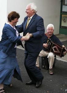 Muiris Ó Rócháin dances a figure with Marie Conway